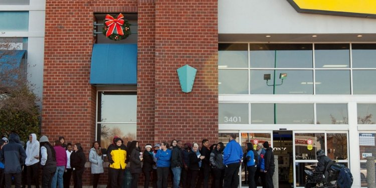 Photo of shoppers waiting for