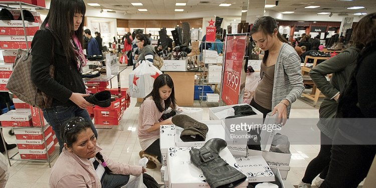 Shoppers browse shoes in a