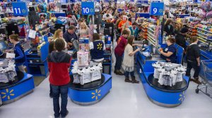 consumers summary their vacation shopping during Walmart's Ebony Friday activities on Thursday, Nov. 27, 2014 in Bentonville, Ark.