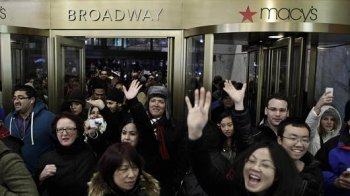 individuals enter Macy's Herald Square once the shop starts its doorways at 8 pm Thanksgiving day on November 28, 2013 in nyc.