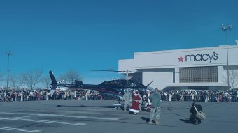 Santa and Mrs. Claus fly to University Mall in a helicopter for Black Friday.